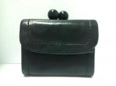 TSUMORI CHISATO(ツモリチサト)の3つ折り財布
