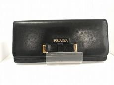 PRADA(プラダ) 長財布 - 黒×ゴールド リボン レザー×金属素材