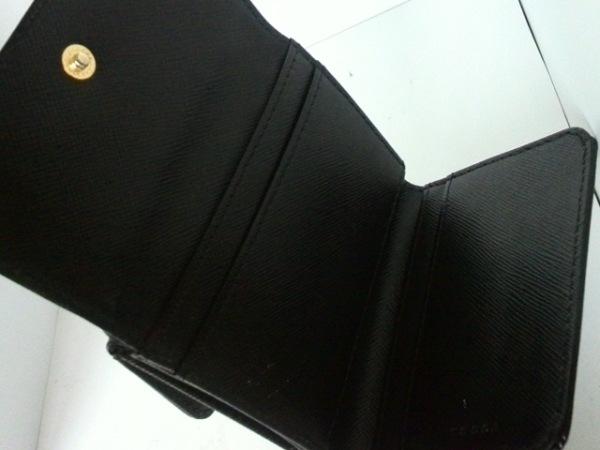 トッカ Wホック財布美品  黒×ゴールド リボン レザー×金属素材 3