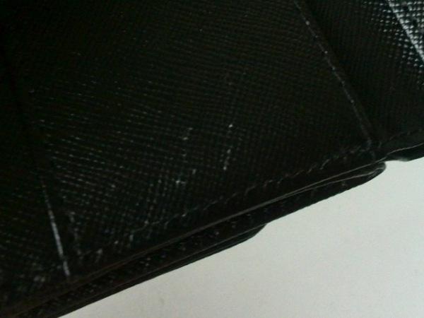 トッカ Wホック財布美品  黒×ゴールド リボン レザー×金属素材 6