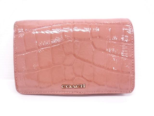wholesale dealer c82ca 44f4e COACH(コーチ) 2つ折り財布 - ピンク 型押し加工 エナメル(レザー)