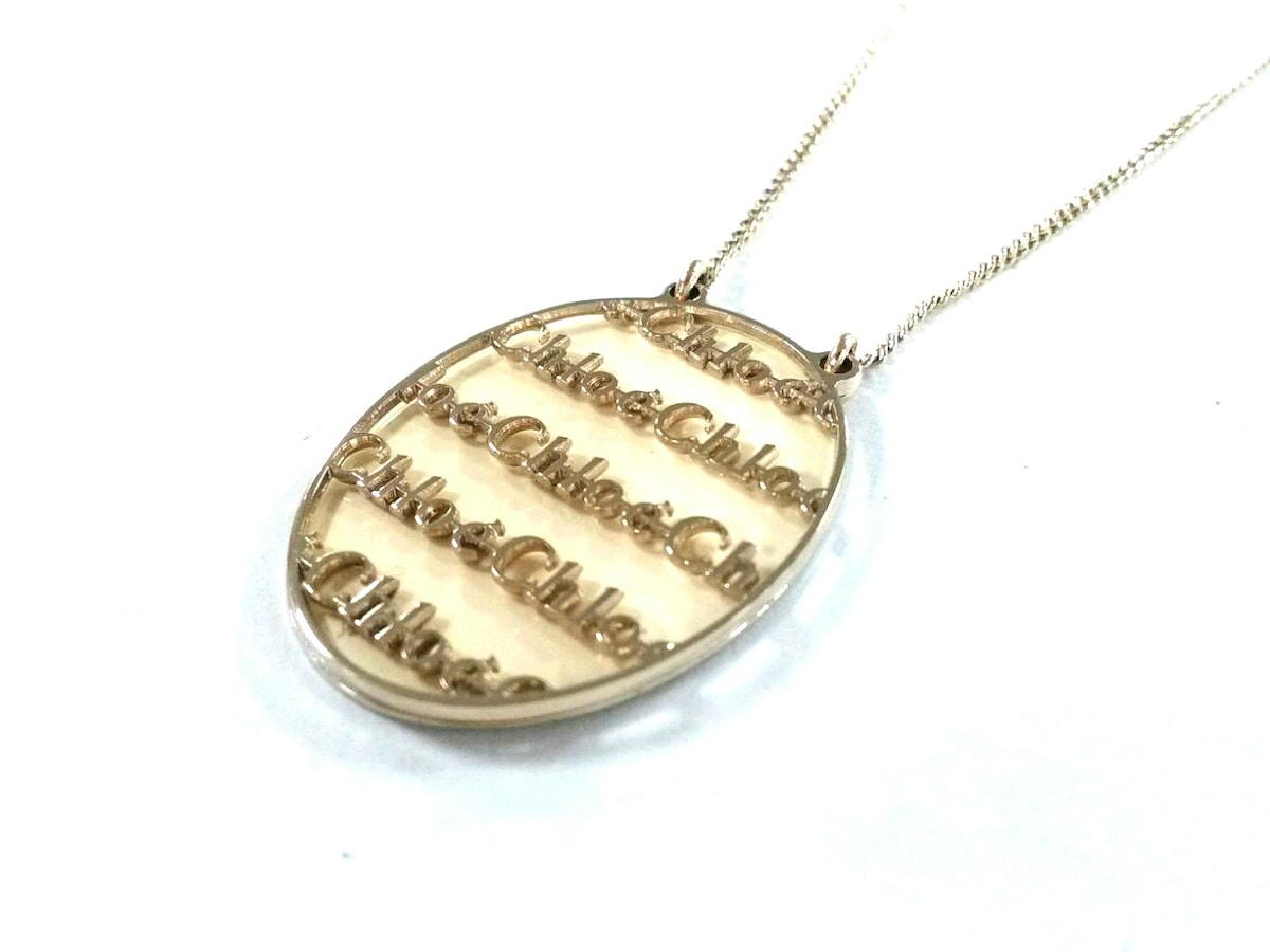outlet store b57c7 8aef2 Chloe(クロエ) ネックレス美品 金属素材 ゴールド×アイボリー