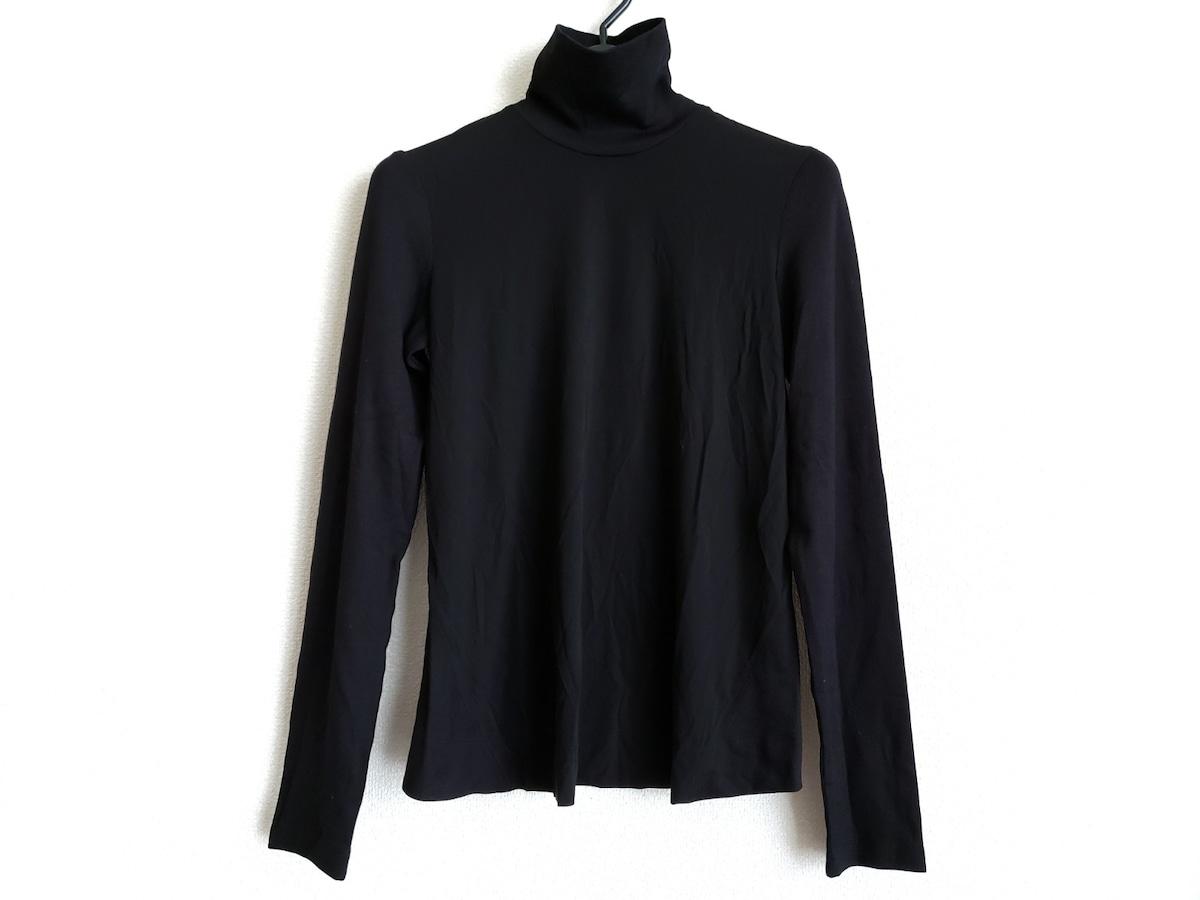 DONNAKARAN(ダナキャラン)のTシャツ