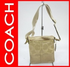 COACH(コーチ)のシグネチャーストライプステッドスウィングバッグのショルダーバッグ