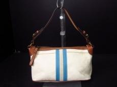 COACH(コーチ)のシグネチャーストライプデミポーチのハンドバッグ