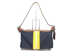 COACH(コーチ)のマディソン パッチワーク シグネチャー クラッチデニムのハンドバッグ
