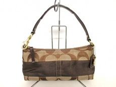 COACH(コーチ)のシグネチャーストライプスモールのハンドバッグ
