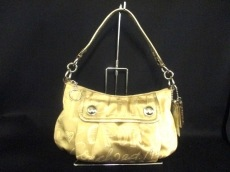 COACH(コーチ)のポピー ストーリー パッチ グルーヴィーのハンドバッグ