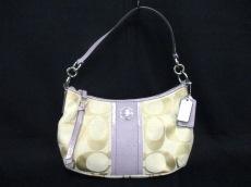 COACH(コーチ)のシグネチャーストライプ デミ クロスボディーのハンドバッグ