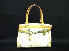 COACH(コーチ)のシグネチャーミディアムキャリーオールのハンドバッグ