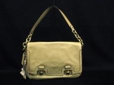 COACH(コーチ)のポピーレザープッシュロックフラップのハンドバッグ
