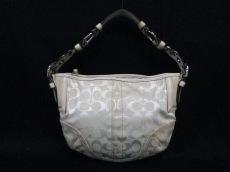 COACH(コーチ)のソーホー シグネチャー ホーボーのハンドバッグ