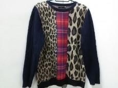 アームドのセーター