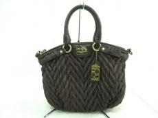 COACH(コーチ)のマディソン シェブロン ナイロン ミニソフィア サッチェルのハンドバッグ