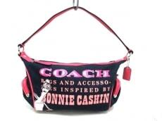 COACH(コーチ)のボニープリントトップハンドルのハンドバッグ
