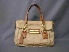 COACH(コーチ)のクリスティンシグネチャーフラップサッチェルハンドバッグのハンドバッグ