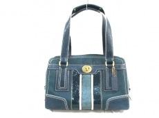 COACH(コーチ)のシグネチャーストライプミディアムキャリオールのハンドバッグ
