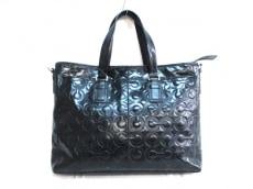 COACH(コーチ)のメンズエンボスドオプアートレザーミディアムビジネストートのビジネスバッグ