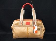 COACH(コーチ)のハンプトンズウィークエンドスモールトートのハンドバッグ