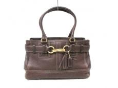 COACH(コーチ)のハンプトンズペブルドレザーミディアムキャリオールのハンドバッグ