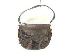 COACH(コーチ)のシグネチャーパッチワークのハンドバッグ