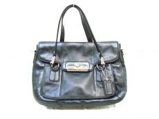 COACH(コーチ)のクリスティン フラップ レザー サッチェルのハンドバッグ