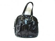 COACH(コーチ)のポピーパテントウィズフラワーハイライトのハンドバッグ