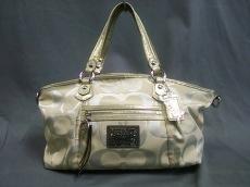 COACH(コーチ)のポピー シグネチャー サティーン ルレックス ロッカー ショルダーバッグのハンドバッグ