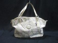 COACH(コーチ)のシグネチャー ストライプ ポケットのハンドバッグ