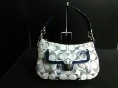 COACH(コーチ)のポピーシグネチャー グルービーハートのハンドバッグ