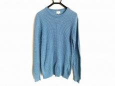 アイボリーコートのセーター