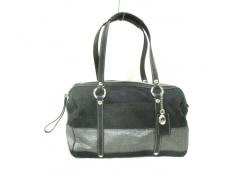 COACH(コーチ)のシグネチャー ストライプ ジップ サッチェルのハンドバッグ