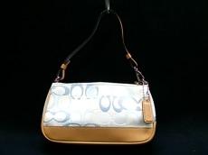 COACH(コーチ)のチェルシーオプティックシグネチャー デミポーチのハンドバッグ