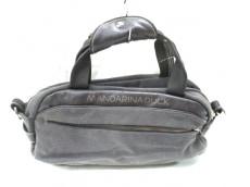 マンダリナダックのハンドバッグ