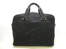 COACH(コーチ)のハドソンミニシグネチャー コミューターのビジネスバッグ