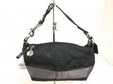 COACH(コーチ)のシグネチャー ストライプ トップハンドル ポーチのハンドバッグ