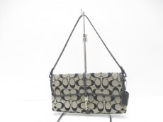COACH(コーチ)のシグネチャー クリップデミポーチのハンドバッグ