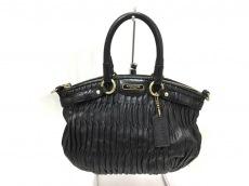 COACH(コーチ)のマディソン ギャザード レザー ミニ ソフィアのハンドバッグ