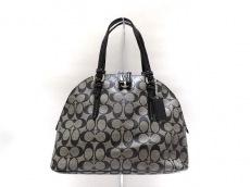 COACH(コーチ)のペイトン シグネチャー コーラドーム サッチェルのハンドバッグ