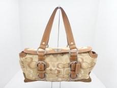 COACH(コーチ)のチェルシーオプティックシグネチャーサッチェルのハンドバッグ