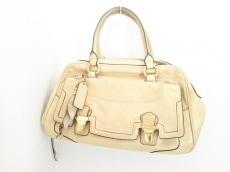 COACH(コーチ)のポピー レザー プッシュロック サッチェルのハンドバッグ