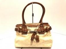 COACH(コーチ)のハンプトンズ シグネチャー キャリオールのハンドバッグ