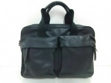 COACH(コーチ)のトンプソン スリムコミューター ブリーフケースのビジネスバッグ