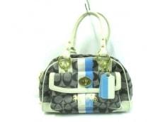 COACH(コーチ)のヘリテージストライプスモールドームドサッチェルのハンドバッグ
