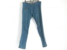 グエル マスタードのジーンズ