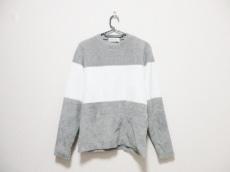 シーグリーンのセーター