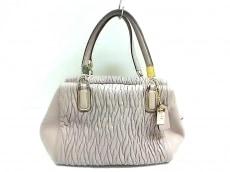 COACH(コーチ)のマディソン ギャザー ツイスト ミニ サッェルのハンドバッグ