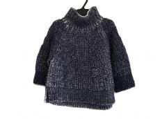 サポートサーフェスのセーター