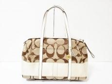 COACH(コーチ)のシグネチャーストライプサッチェルのハンドバッグ