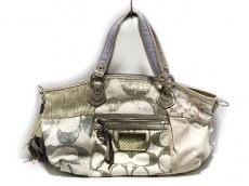 COACH(コーチ)のポピー デニム パッチワーク ロッカーのハンドバッグ